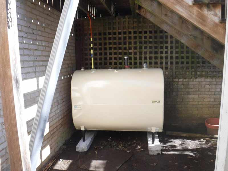 above ground oil tank under stairs